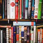 bookshelf overflowing with books